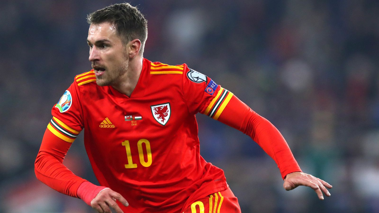 Wales Team Guide: Aaron Ramsey in action for Wales